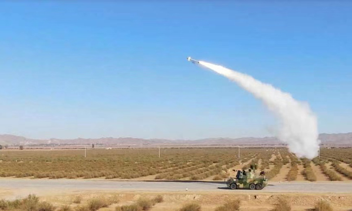 An HQ-17AE troop-accompanying field air defense missile system in action. Photo: Courtesy of CASIC