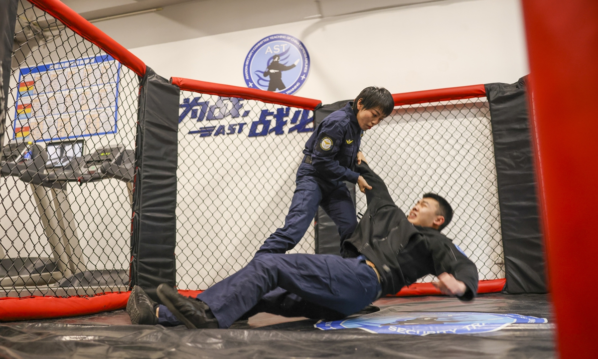 Liu Yao (left), a aviation security officer practices fighting skills with her colleague.