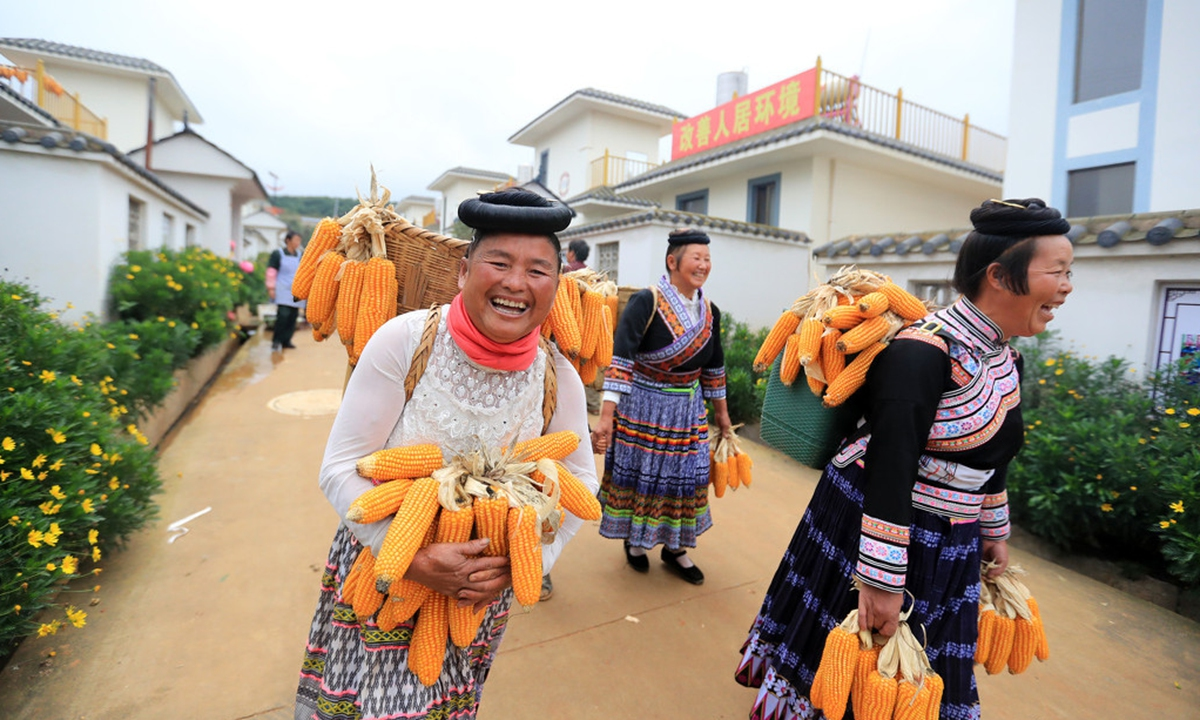 Villagers attend a wedding ceremony held in Xiaohaixin village, their new living community after poverty alleviation relocation, Xundian county, Southwest China's Yunnan. Photo: IC