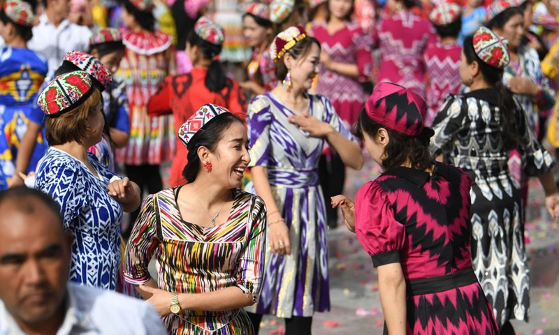 People dance at a square during a culture and tourism festival themed on Dolan and Qiuci culture in Awat County of Aksu Prefecture, northwest China's Xinjiang Uygur Autonomous region, Oct. 25, 2019.Photo:Xinhua