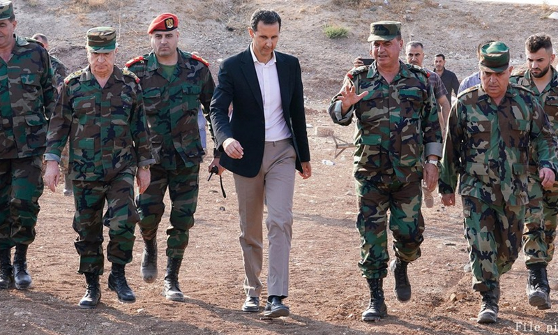 Syrian President Bashar al-Assad meets Syrian soldiers in a military base in the town of Habit in the countryside of Idlib province in northwestern Syria on Oct. 22, 2019.(Photo: Xinhua)