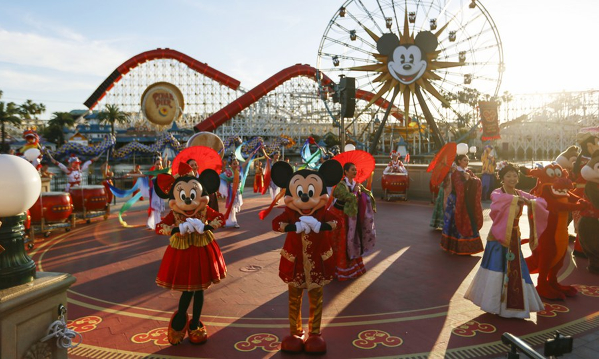 Characters of Disney greet visitors during the Chinese Lunar New Year celebrations at Disney's California Adventure Park in Anaheim, the United States, Jan. 17, 2020. (Xinhua/Li Ying)