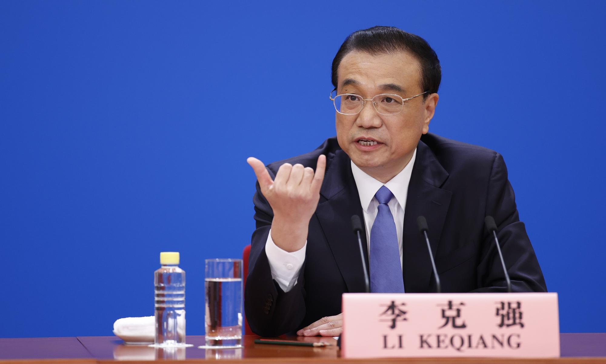 Chinese Premier Li Keqiang gestures a