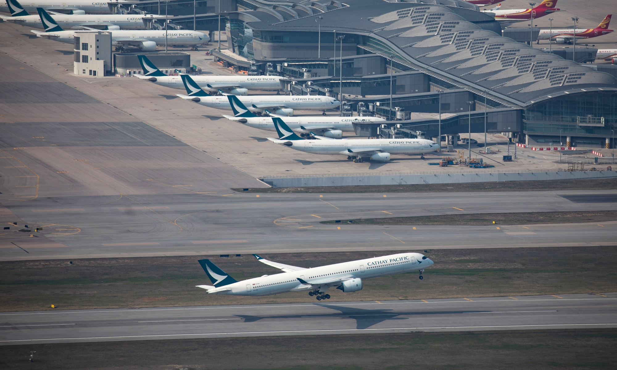 An aircraft operated by Cathay Pacific Airways takes off at the Hong Kong International Airport in Hong Kong, China, on March 9, 2021. Photo: VCG