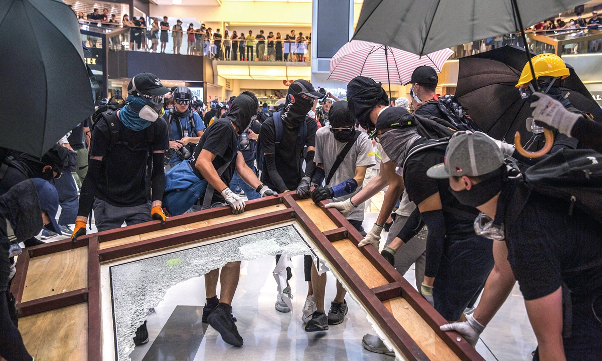 Rioters break items during a protest in September 2019 in Hong Kong. Photo: AFP