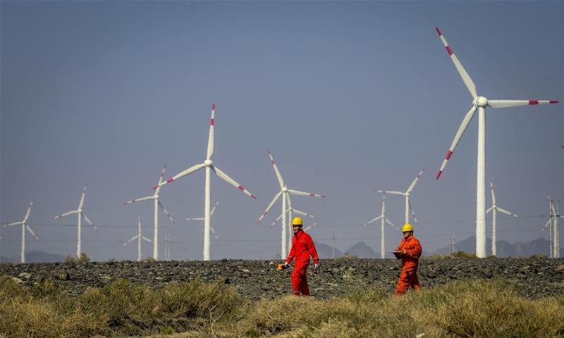 Workers check equipment at a wind power plant in Urumqi, northwest China's Xinjiang Uygur Autonomous Region. File photo: Xinhua