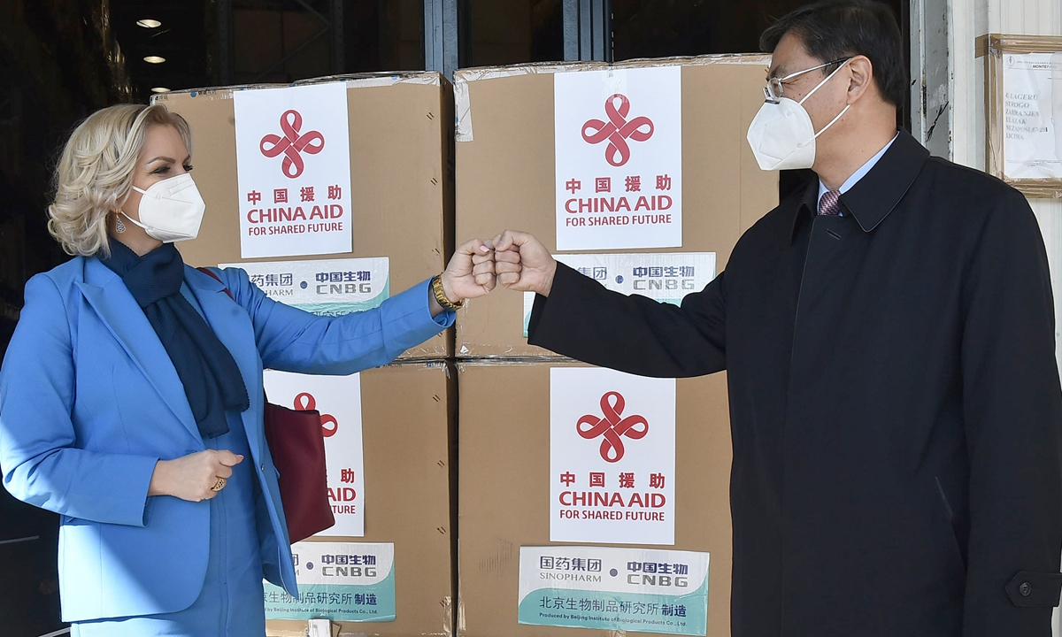 Chinese Ambassador Liu Jin (right) in Montenegro greets with Montenegrin Health Minister when Chinese vaccines arrived in Podgorica on March 7.