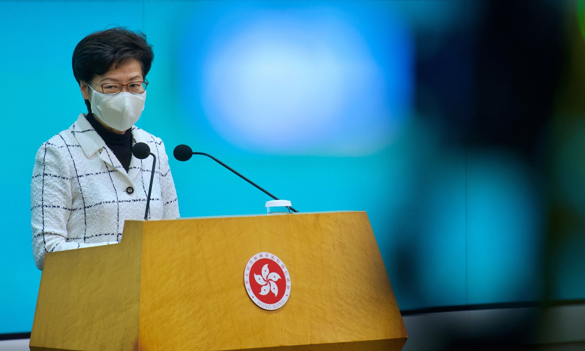 Hong Kong Chief Executive Carrie Lam listens to reporters' questions during a press conference in Hong Kong on Tuesday. Two employees of the US Consulate General in Hong Kong who tested positive for COVID-19 have been hospitalized and one of their daughters is suspected of being infected, Lam said. Photo: VCG