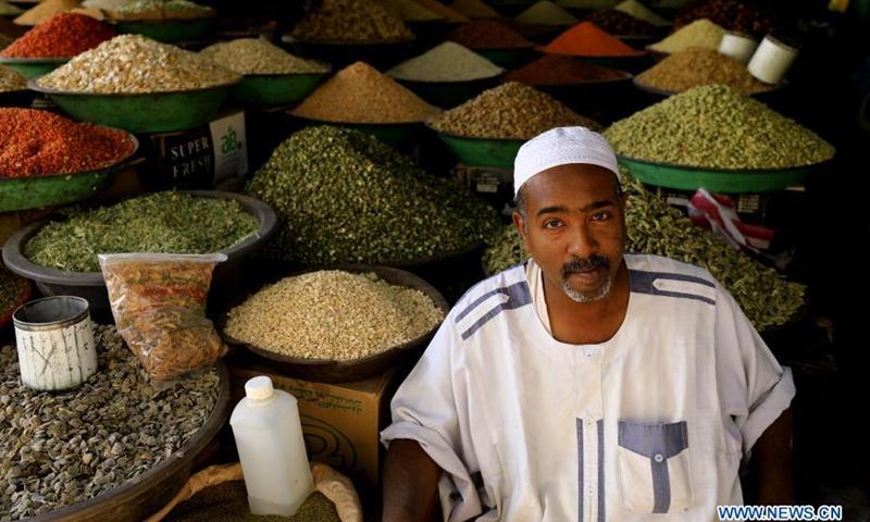 A vendor sells products at a local market in Khartoum, Sudan, March 16, 2021.(Photo: Xinhua)