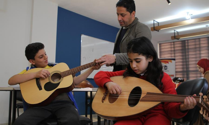 Palestinian children attend a music lesson at the house of Music Center in Gaza City, March 17, 2021. The house of Music is a training center established two months ago. It has currently about 30 students. They practice music on different types of musical instruments such as piano, Qanun, Oud, guitar, and violin.Photo:Xinhua
