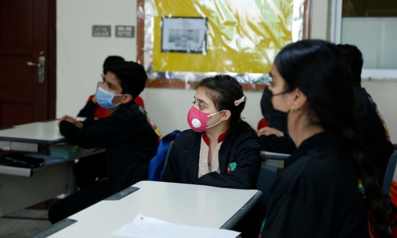 Students attend a Chinese language class at a campus of the Roots Millennium Schools in Islamabad, Pakistan, March 11, 2021. (Photo:Xinhua)