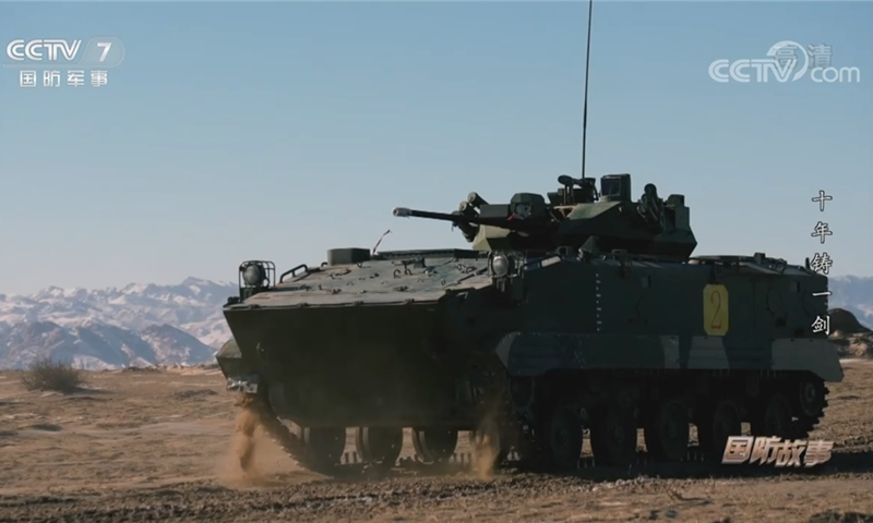 An improved variation of China's Type 03 airborne infantry fighting vehicle tests its new fire control system. The system will enable the air-droppable armored vehicle to fire while moving. Photo: Screenshot from China Central Television