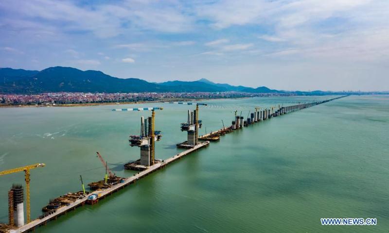 Aerial photo taken on March 10, 2021 shows the construction site of Meizhou Bay cross-sea bridge of the Fuzhou-Xiamen high-speed railway in southeast China's Fujian Province. Photo: Xinhua