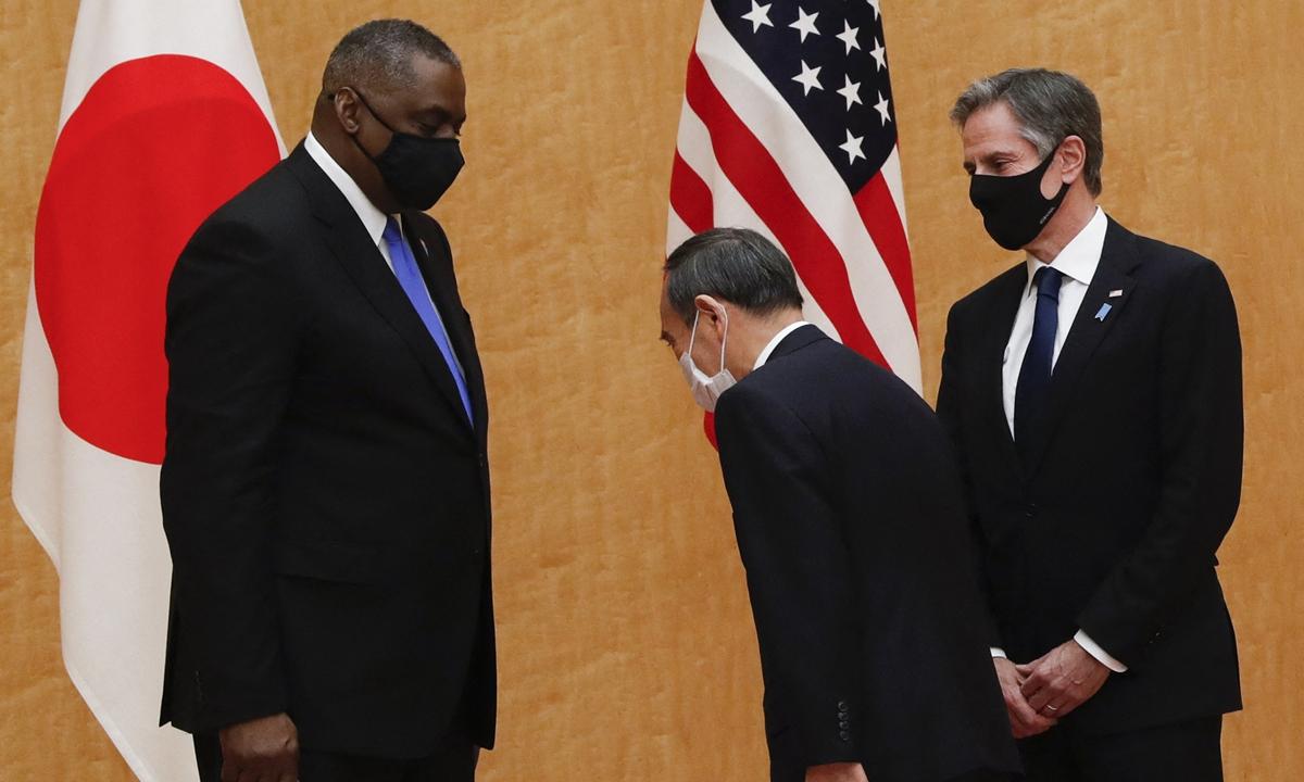 Japanese Prime Minister Yoshihide Suga greeted US Secretary of State Antony Blinken and US Defense Secretary Lloyd Austin. Photo: AFP