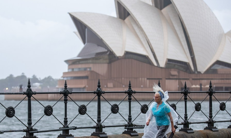 A woman walks in the rain in Sydney, Australia, March 20, 2021.(Photo: Xinhua)