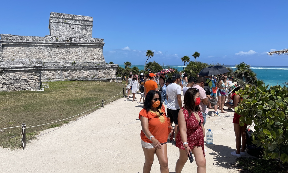 Tourists enjoy the pre-Columbian Mayan site at Tulum built on the eastern coast of the Yucatan Peninsula on the Caribbean Sea, in the Mexican state of Quintana Roo, on March 9. Photos: AFP