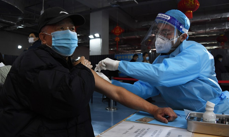 A resident is inoculated at a vaccination site at Yongdinglu Sub-district of Haidian District in Beijing, China, March 14, 2021.(Photo: Xinhua)