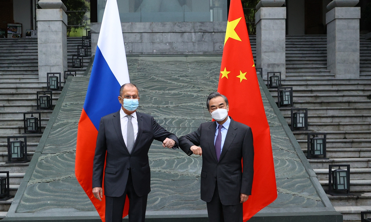 Chinese State Councilor and Foreign Minister Wang Yi (right) meets with Russian Foreign Minister Sergei Lavrov in Guilin, South China's Guangxi Zhuang Autonomous Region on Monday. Photo: AFP
