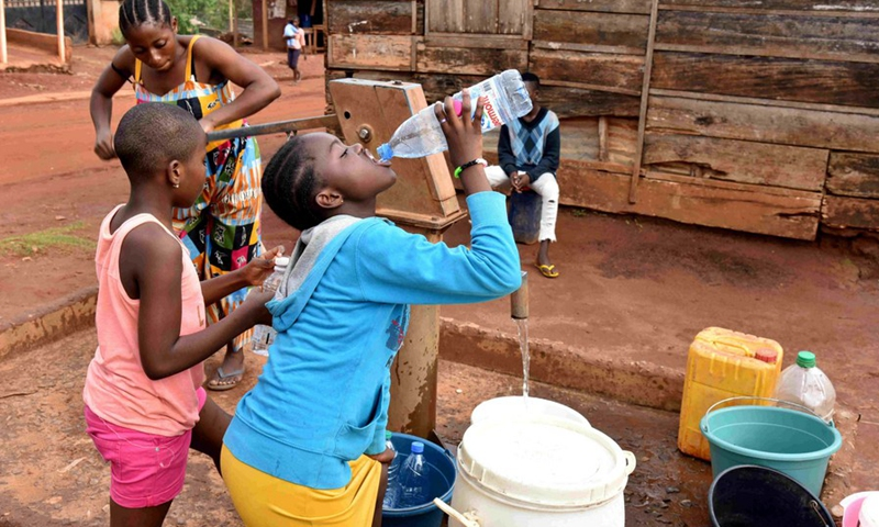 People fetching water from a borehole in Ekie-South, a peri-urban neighborhood in Cameroon's capital city Yaounde, March 19, 2021.(Photo: Xinhua)