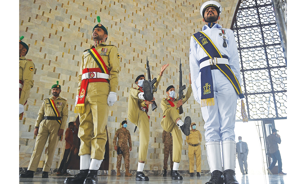 Ceremonial guards take part in a ceremony to mark Pakistan's National Day at the mausoleum of founding leader Mohammad Ali Jinnah in Karachi, Pakistan, on Tuesday. Pakistan Day is a public holiday celebrated annually on March 23 in Pakistan. The day is observed as a public holiday in all federal and provincial government offices, banks and private sectors. Photo: AFP