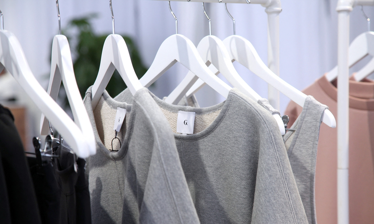 Clothes are inspected during the In goop Health Summit San Francisco 2019 at Craneway Pavilion on November 16, 2019 in Richmond, California. Photo: AFP
