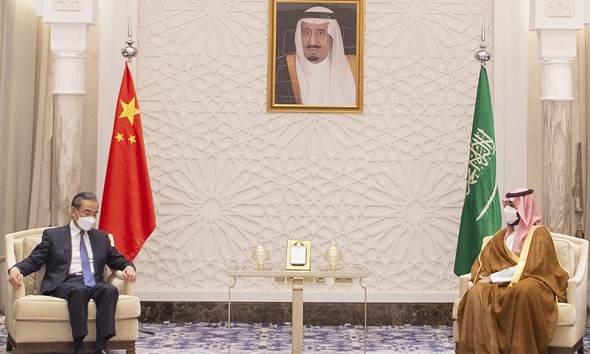 Chinese State Councilor and Foreign Minister Wang Yi (left), meeting with Saudi Arabian Crown Prince Mohammed bin Salman, in the capital Riyadh, on March 24, 2021.