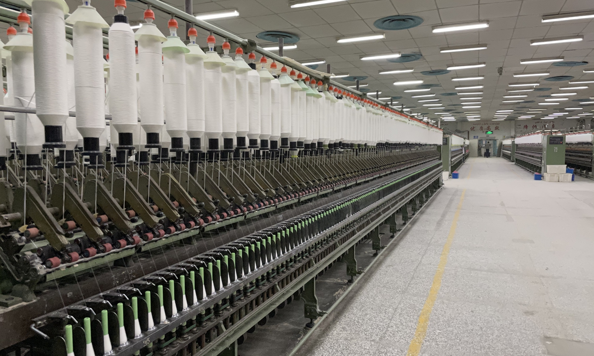 The cotton gins in a coat factory in Northwest China's Xinjiang Uygur Autonomous Region