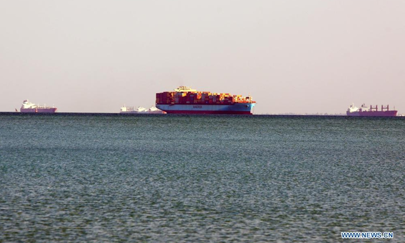 Ships wait to pass the Suez Canal on the Great Bitter Lake, in the province of Ismailia, Egypt, March 25, 2021. Egypt's Suez Canal Authority (SCA) said on Thursday that it has temporarily suspended navigation through the world's busiest shipping course until the grounded cargo ship is completely freed.Photo:Xinhua