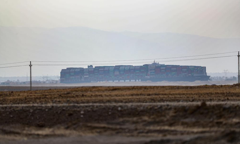 Photo taken on March 25, 2021 shows the grounded container ship Ever Given on the Suez Canal, Egypt. Egypt's Suez Canal Authority (SCA) said on Thursday that it has temporarily suspended navigation through the world's busiest shipping course until the grounded cargo ship is completely freed.Photo:Xinhua