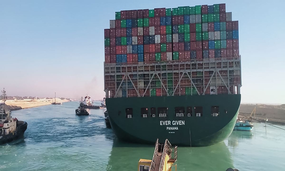 This picture taken on Monday from a nearby tugboat in the Suez Canal shows a view of the Ever Given, a Panama-flagged cargo ship, as it begins to move. Egypt's Suez Canal Authority said on Monday the Ever Given container ship, which has been blocking the crucial waterway for nearly a week, has been turned in the
