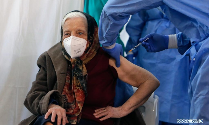 Zoea Baltag, 105-year-old, receives the second shot of COVID-19 vaccine at a hospital in Bucharest, Romania, March 28, 2021.(Photo: Xinhua)