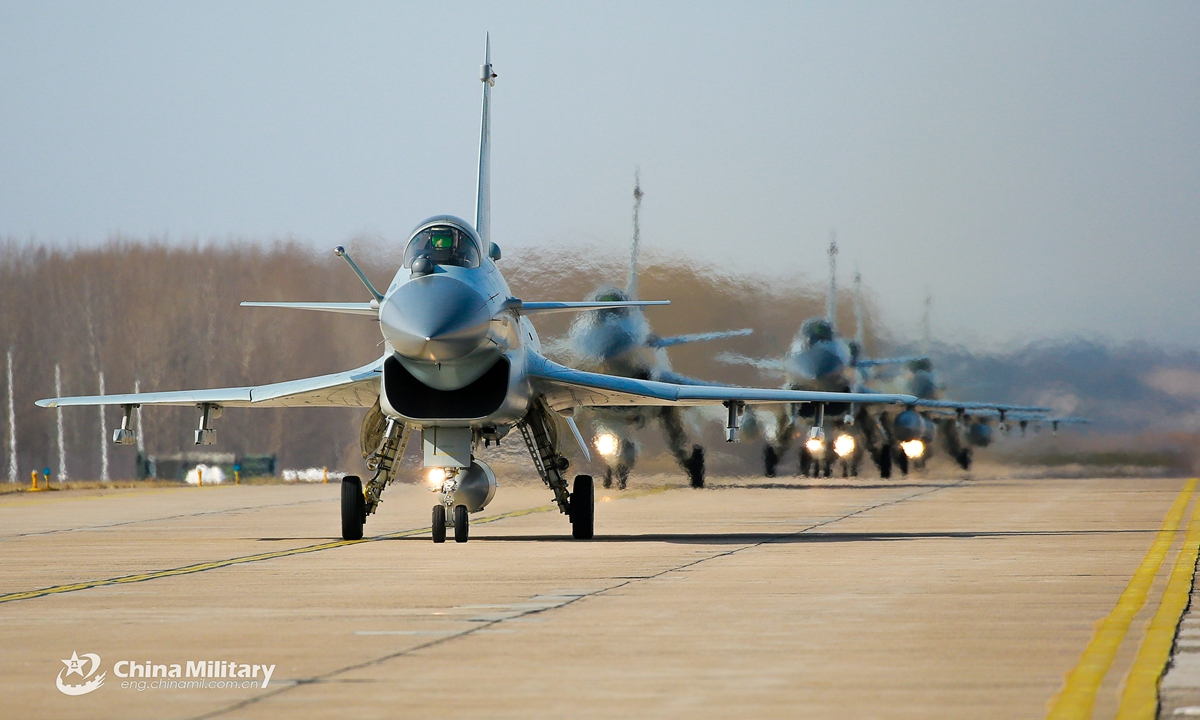 Four pilots and two instructors assigned to an aviation brigade of the air force under the PLA Northern Theater Command taxi their fighter jets on the flightline in formation during a flight exam on February 26, 2021. The four pilots have just completed the training on flight combat skills, which focused on aerial confrontation and flexible tactical options, aiming to enhance the flying skills and tactical cooperation among the pilots. Photo: China Military Online
