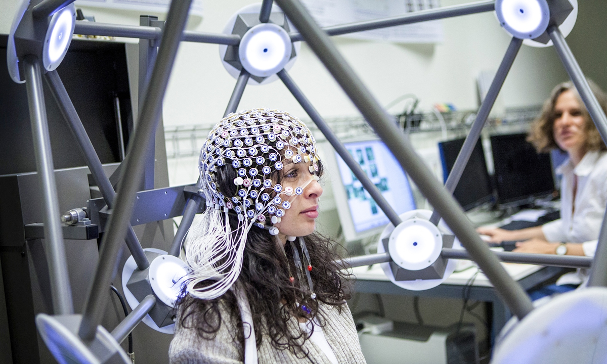 Researchers use electroencephalography on a person to measure brain activity. Photo: AFP