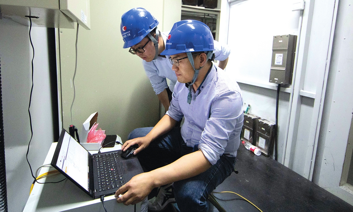 Employees maintain the devices inside the FAST Photo: Xinhua