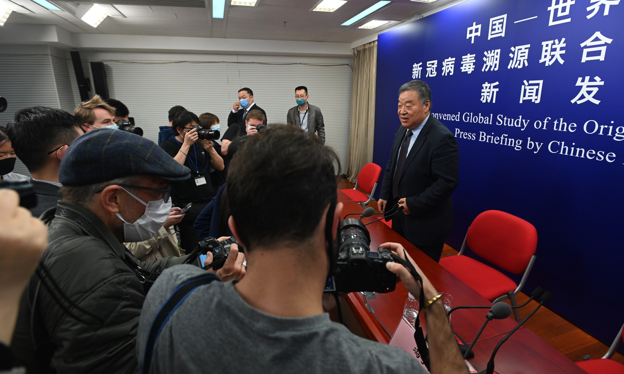Liang Wannian, team leader of the Chinese side of the WHO-China joint expert team, takes questions on the joint report on coronavirus origins at Wednesday's press conference. Photo: VCG