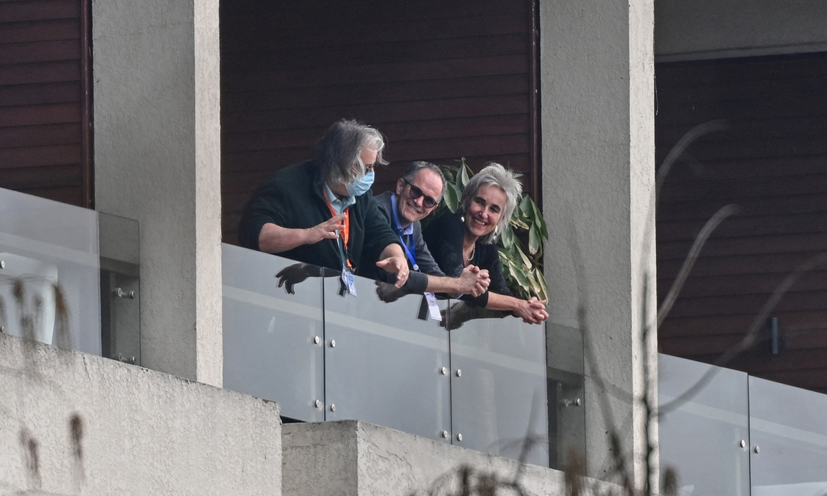 Peter Ben Embarek (center), Marion Koopmans (right) and other members of the World Health Organization (WHO) team investigating the origins of the coronavirus, are seen on a balcony at the Wuhan Hilton Optics Valley Hotel in Wuhan, Central China's Hubei Province on Monday. Photo: AFP