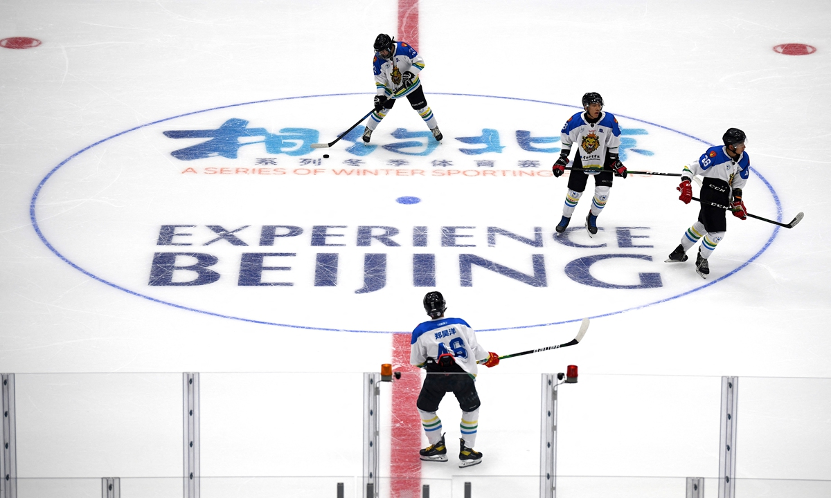 Ice hockey players practise during a test event for the 2022 Beijing Winter Olympic Games at the National Indoor Stadium in Beijing on Thursday. The test event series will run until April 10. Photo: AFP