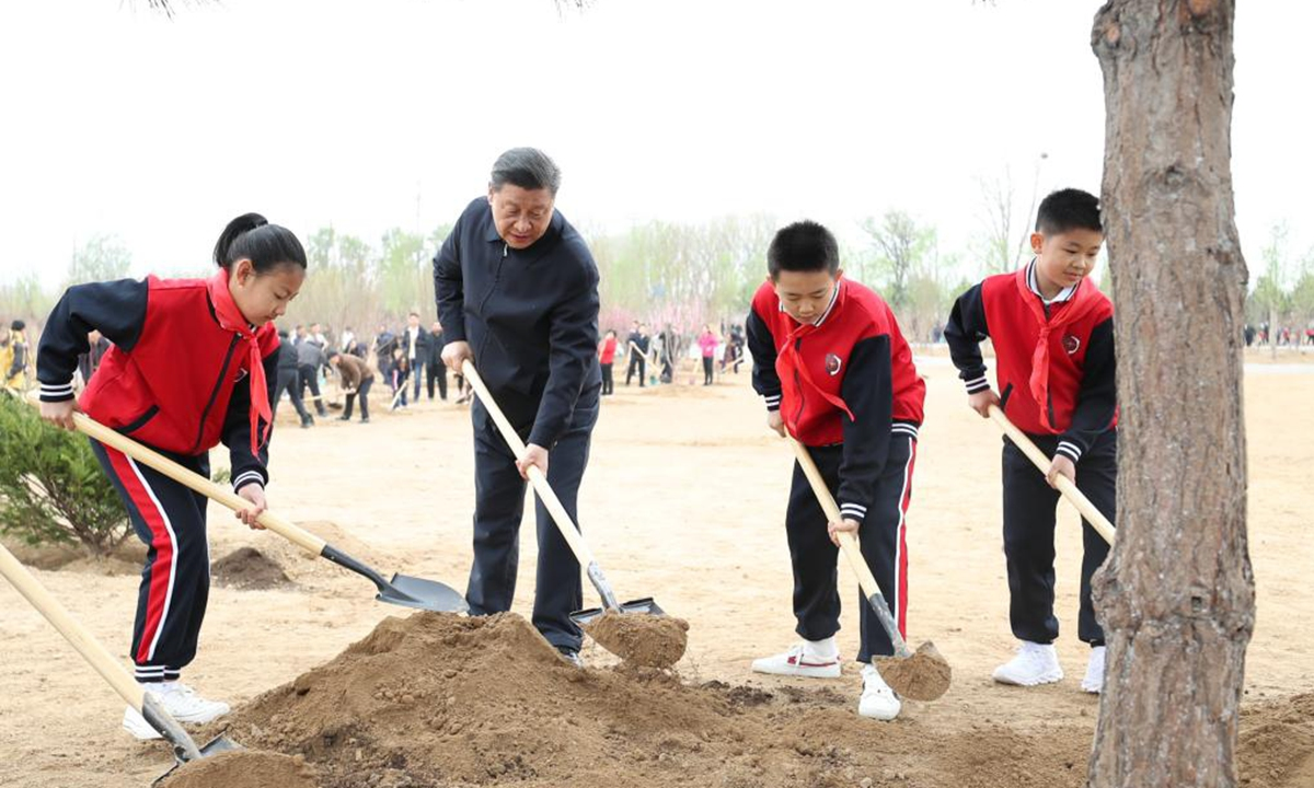Chinese President Xi Jinping, also general secretary of the Communist Party of China Central Committee and chairman of the Central Military Commission, plants a tree during a tree-planting activity in Chaoyang District in Beijing, capital of China, April 2, 2021. The activity was also attended by other leaders including Li Keqiang, Li Zhanshu, Wang Yang, Wang Huning, Zhao Leji, Han Zheng and Wang Qishan. (Xinhua/Huang Jingwen)