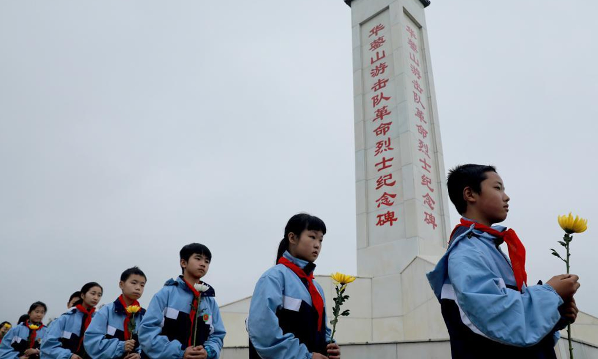 Primary school students pay tribute to martyrs at a cemetery in Huaying City, southwest China's Sichuan Province, April 1, 2021. The Tomb-sweeping Day, also known as Qingming Festival, which falls on April 4 this year, is a Chinese festival when people pay tribute to the dead and worship their ancestors by visiting tombs and making offerings. (Photo by Zhou Songlin/Xinhua)