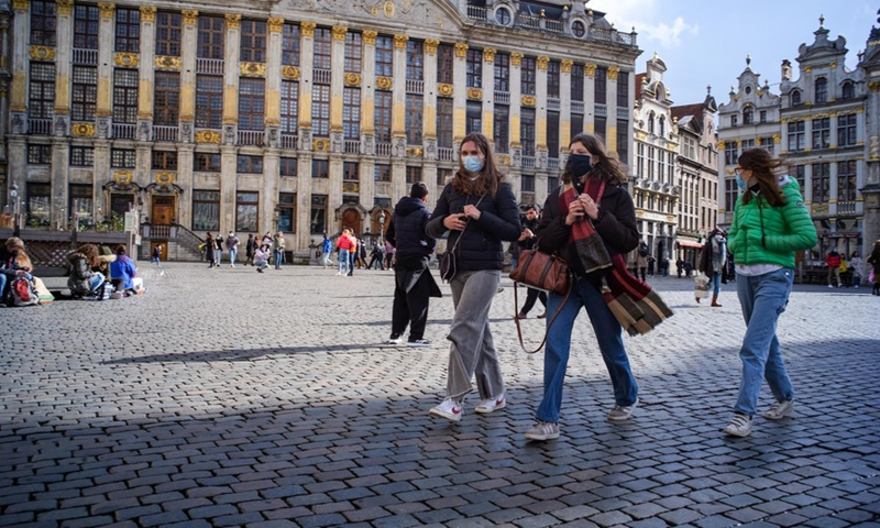 People wearing face masks walk on the Grand Place in Brussels, Belgium, on March 13, 2021.(Photo: Xinhua)