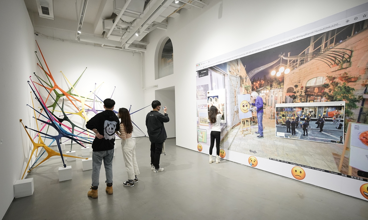 Visitors explore the ongoing <em>Systematic Evolution</em> exhibition in Beijing.  Photo: Courtesy of Hongkun Museum of Fine Art