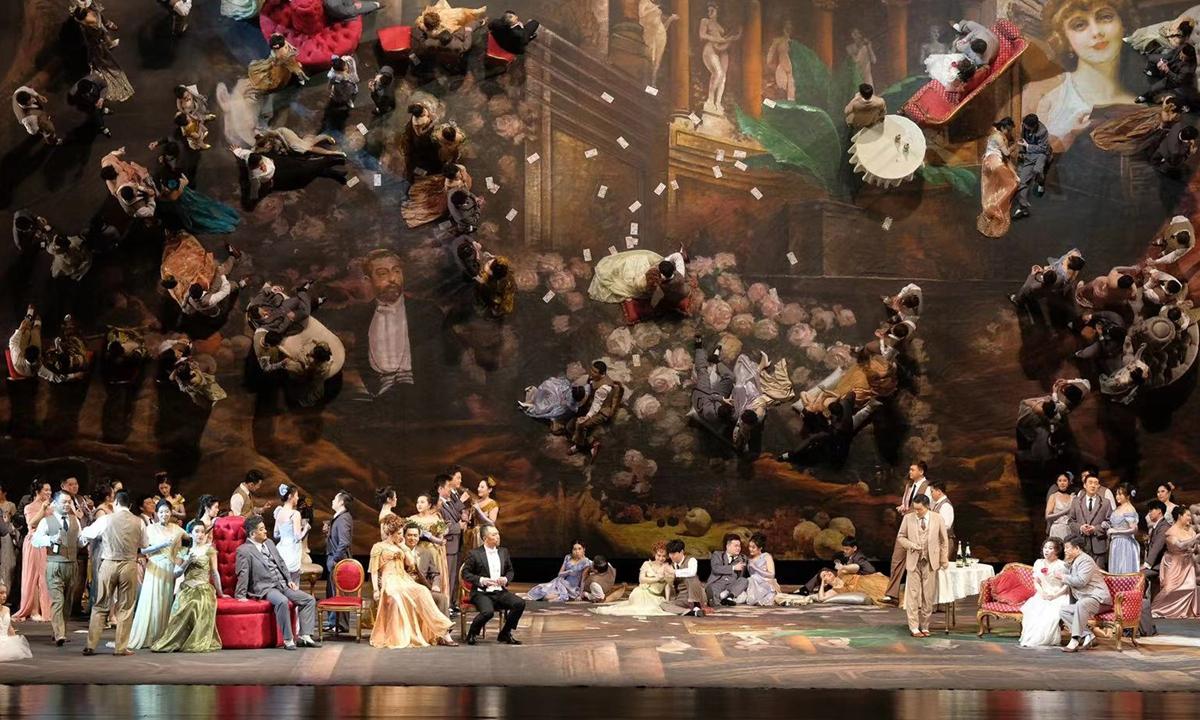 Top: Conductor Yu Long   A scene from <em>La Traviata</em> Photos: Courtesy of the Shanghai Symphony Orchestra