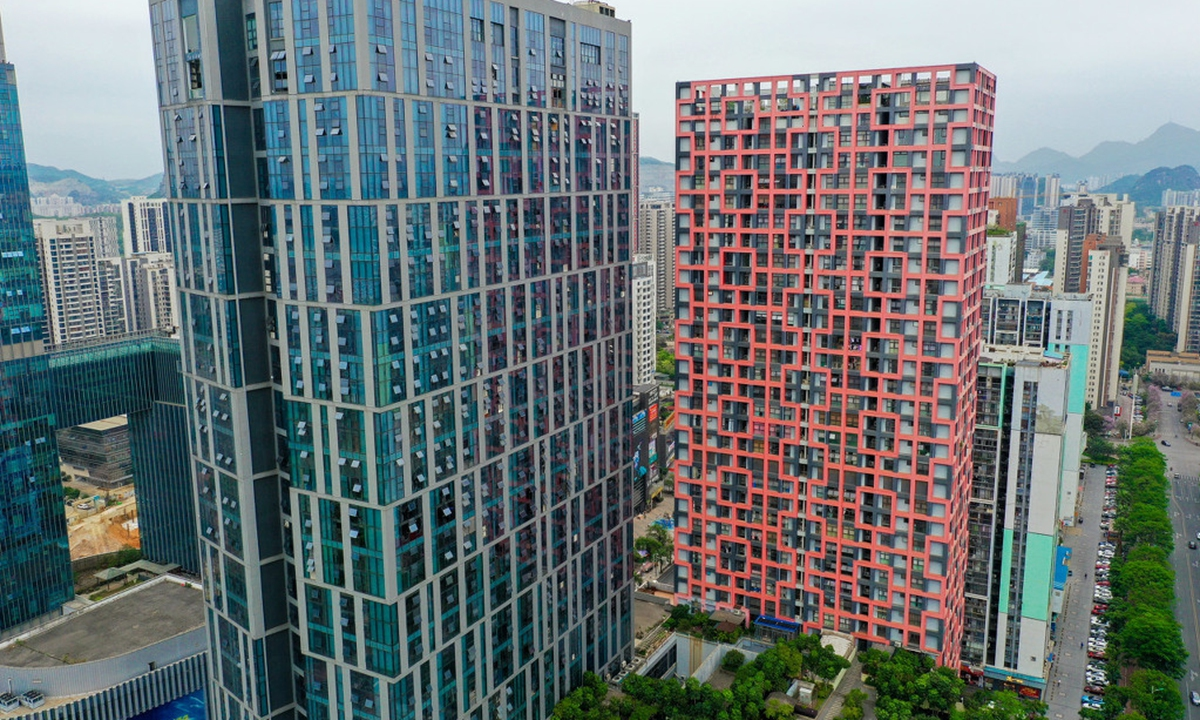 A building in Liuzhou, South China's Guangxi Zhuang Autonomous Region, whose facade is woven with red ribbons in the shape of Chinese knots, catches people's attention recently. Photo: IC