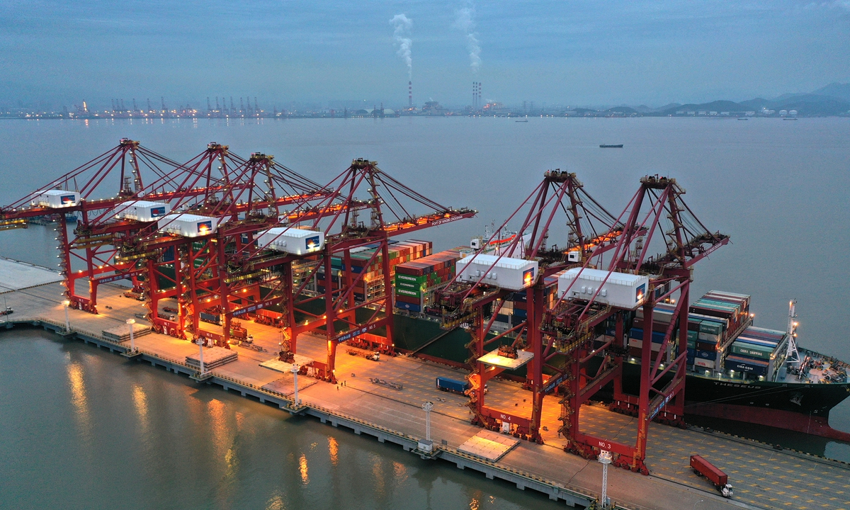 A ship berths at Ningbo Zhoushan port on Tuesday. Official data showed that Ningbo Zhoushan port handled cargo throughput of 193.34 million tons in January and February, a year-on-year increase of 18.4 percent. Photo:cnsphoto