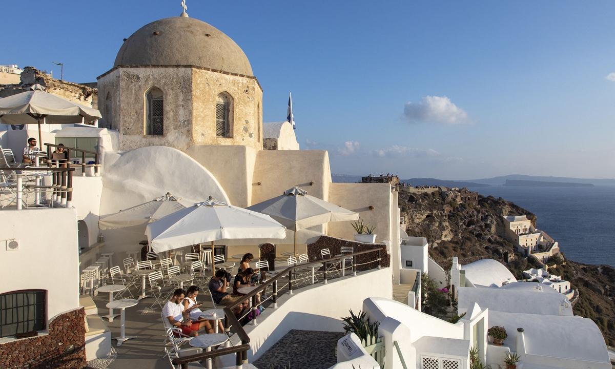 An outdoor restaurant in Santorini Island in Greece Photo: AFP