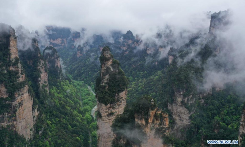 Aerial photo taken on April 7, 2021 shows the mountains shrouded by cloud and mist in Zhangjiajie National Forest Park, central China's Hunan Province.(Photo: Xinhua)