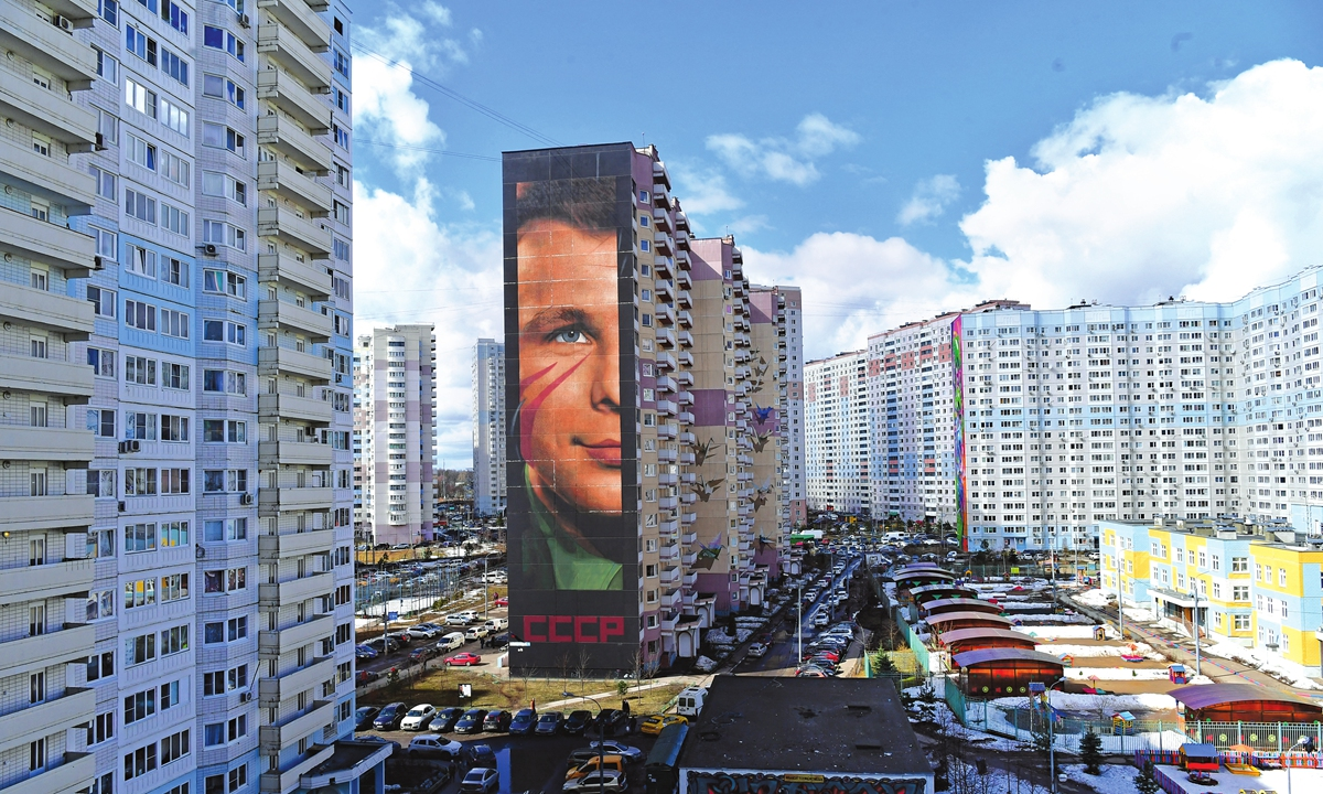 Graffiti with the image of Yuri Gagarin occupying the entire end wall of a multistory residential building, is seen in Odintsovo, Moscow region, Russia, on Sunday. Photo: AFP
