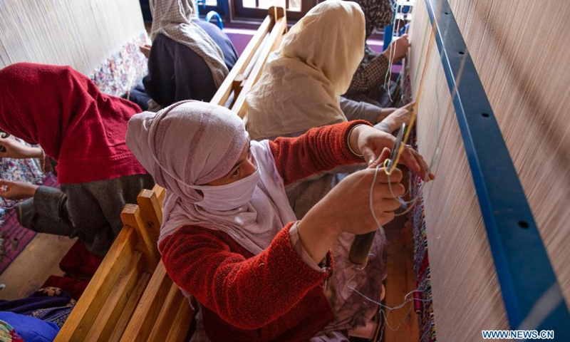 People work at a carpet-weaving workshop in Kokernag village of Anantnag district in Srinagar city, the summer capital of Indian-controlled Kashmir, April 7, 2021.(Photo: Xinhua)