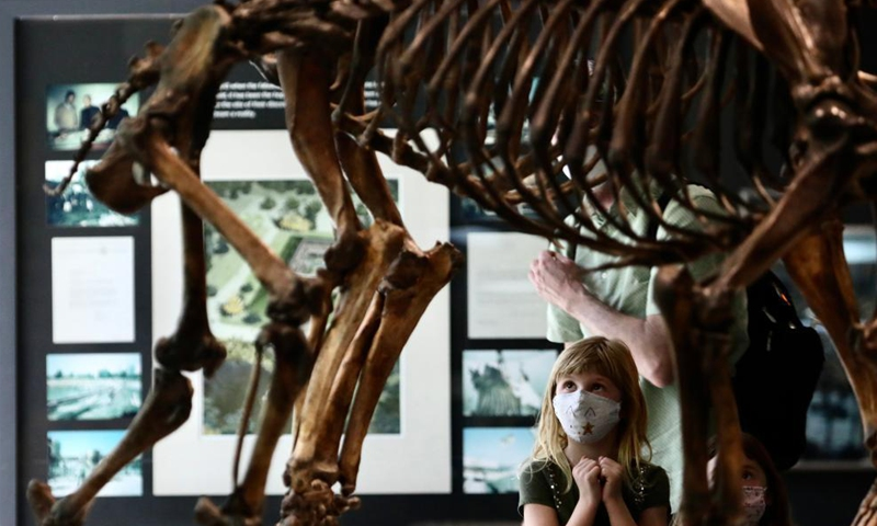 A child visits the La Brea Tar Pits and Museum in Los Angeles, California, the United States, on April 8, 2021. After more than a year of COVID-19 closure, the La Brea Tar Pits and Museum in Los Angeles reopened to the public on Thursday. Museums, galleries, botanical gardens, zoos and aquariums in Los Angeles County are allowed to reopen their indoor spaces to the public at 50 percent maximum indoor occupancy after the county enters the Orange Tier.Photo:Xinhua