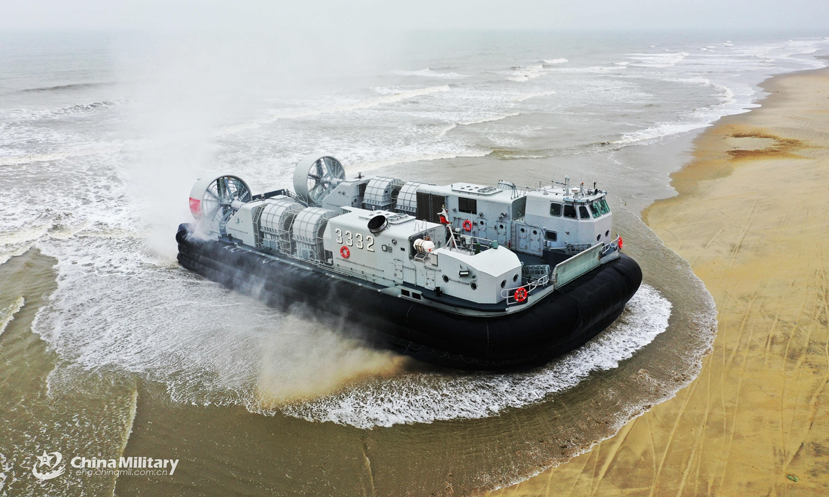 A Landing Craft, Air Cushion (LCAC) attached to a naval landing ship flotilla under the PLA Southern Theater Command arrives on shore during a beach landing training exercise on March 24, 2021. The exercise involved such items as in and out of the mother-ship under complex sea conditions, fast and accurate ferry of troops, and simulated seizure and control of islands.Photo:China Military